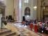 l'arcivescovo bassetti durante l'omelia in san lorenzo con le famiglie di immmigrati